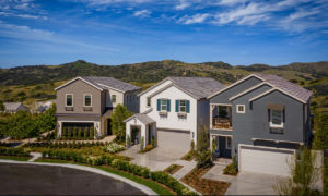 Three California houses with mountains in the background