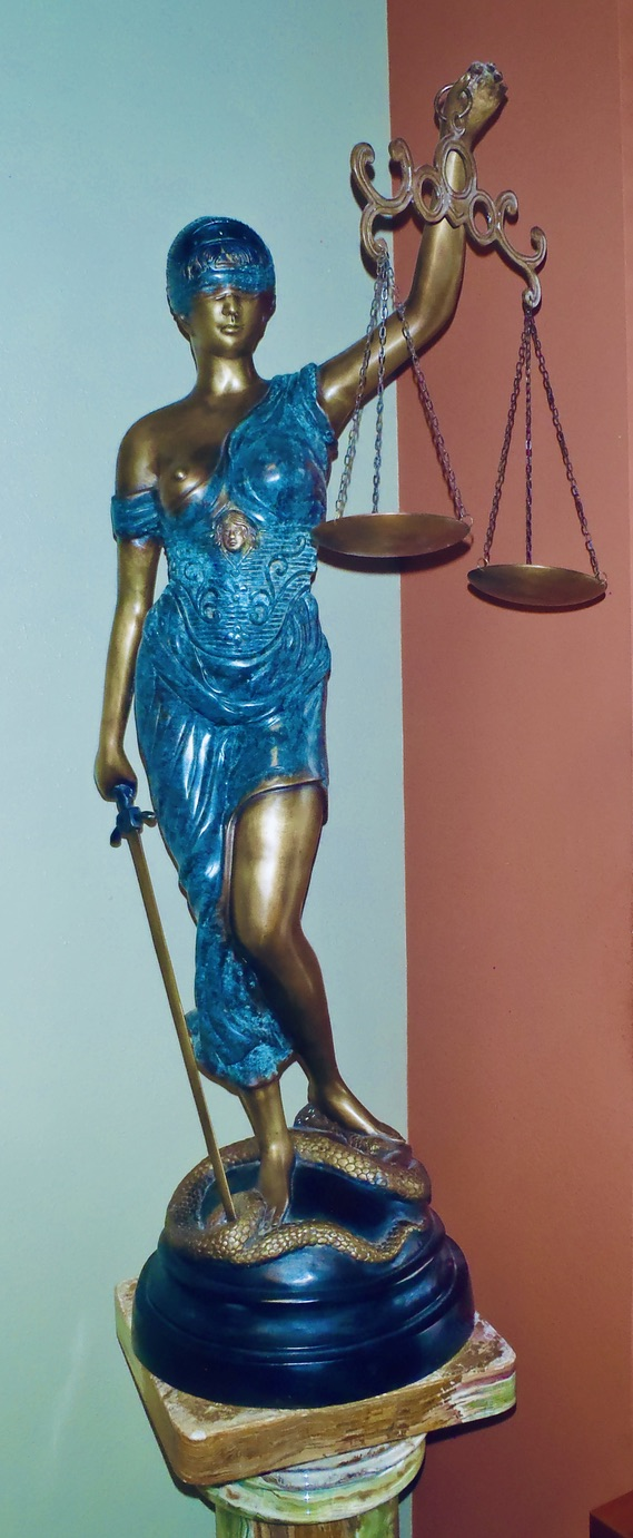 Lady Justice Statue Sits in Elaine's Office